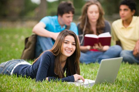 girl-studying-on-grass