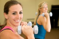 women-lifting-weights-together