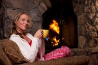 woman-relaxing-fireplace