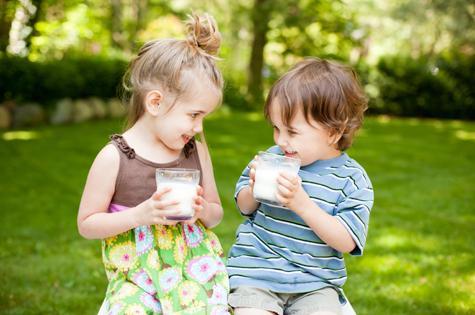 two-children-drinking-milk-low