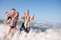 family_playing_in_surf