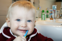 Top apps for teaching kids to brush their teeth - hero image - motherpedia